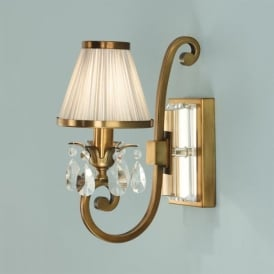 Oksana Single Light Wall Fixture in Antique Brass with a Beige Shade