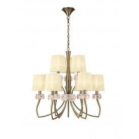 Loewe 9 Light Multi Arm Ceiling Fitting in Antique Brass Finish with Cream Shades
